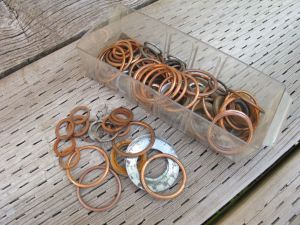 Crushable copper washers