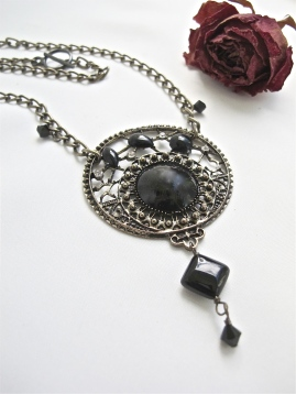 """""""Dark Magic"""" is one of my favourite upcycled pieces. The focal was an earring I found in southern Arizona. I added a glass diamond-shaped bead and several Preciosa crystals. (Sold)"""