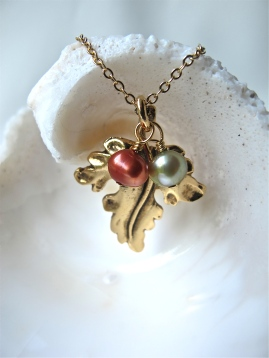I added dyed freshwater pearls to an upcycled gold leaf. The person who bought it loved it because to her it looked like an angel. Ah, the eye of the beholder ... (Sold)